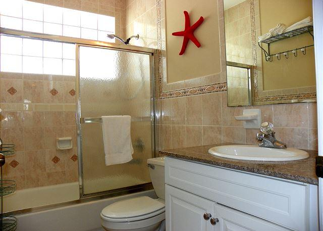 This bathroom is located between bedrooms 1 and 2.
