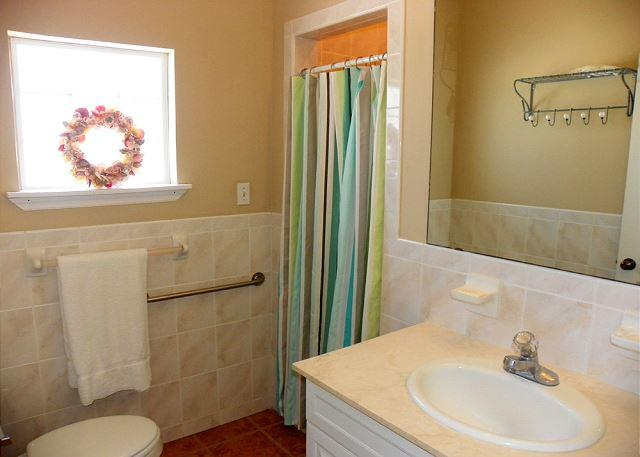 This bathroom services bedrooms 3 and 4 and has a walk in shower.