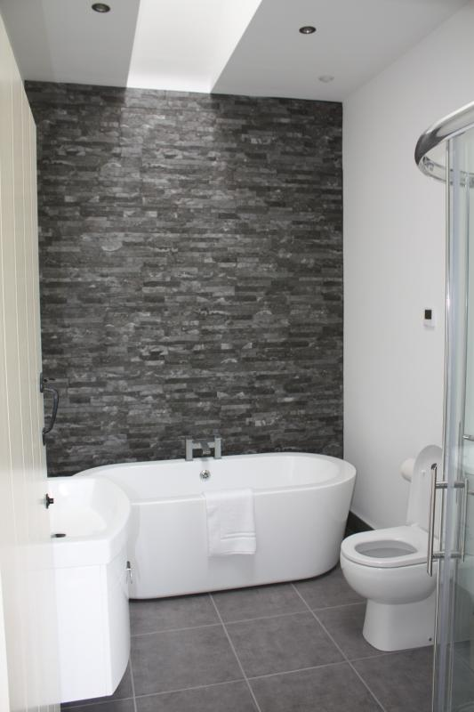 Spacious bathroom with free standing bath and separate shower