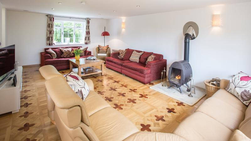 Large Lounge with woodburner and surround sound Smart TV