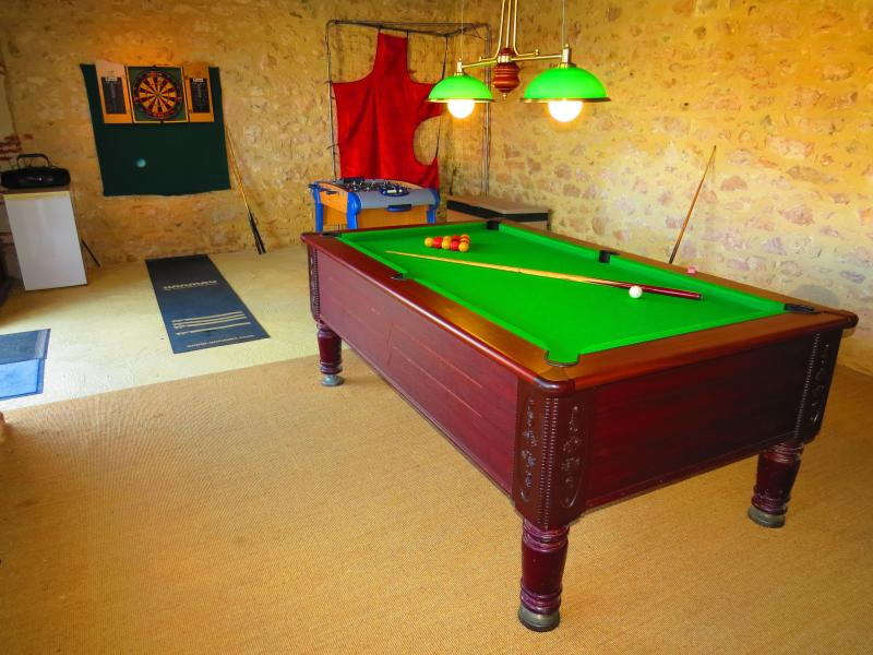 Games room with pool table, table football and darts board.