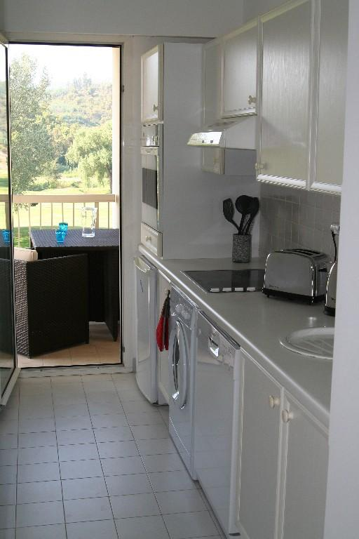Fully equipped kitchen leading on to the balcony