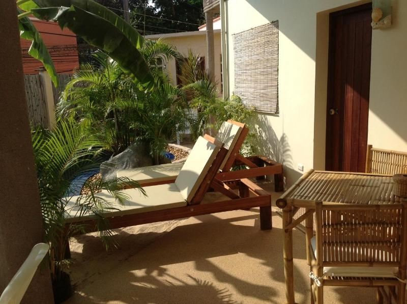 sun loungers in front of north bedroom