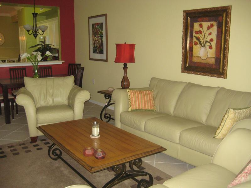 Living Room with Leather Couch, Chair and Love Seat