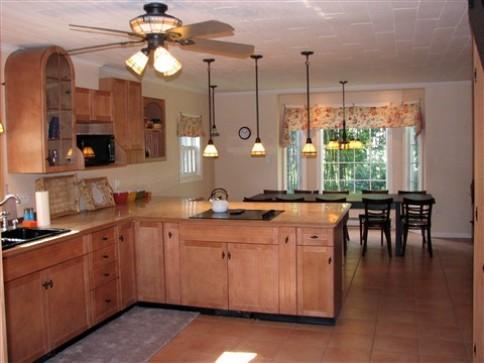 The spacious eat-in kitchen with dishwasher, fridge, microwave, stove, oven, toaster oven, coffee makers...
