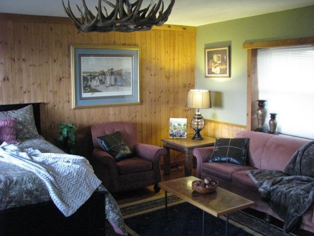 Main floor Queen bedroom/living area with bath.