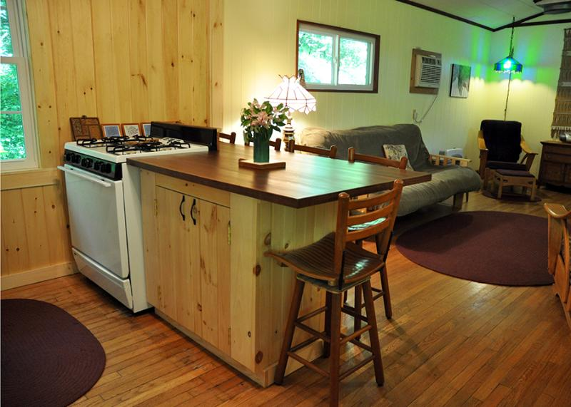 Recently remodeled - the new paneling fills the cabin with the fresh scent of pine.