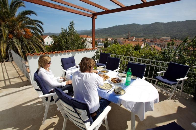 Our terrace has fantastic views over the harbour and ancient old town of Stari Grad.