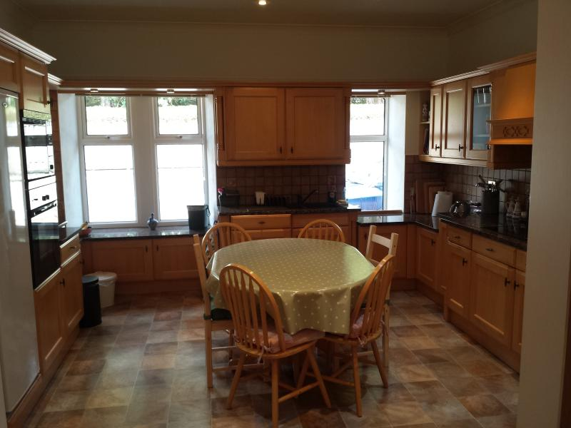 Fully equipped kitchen with doors to patio area.