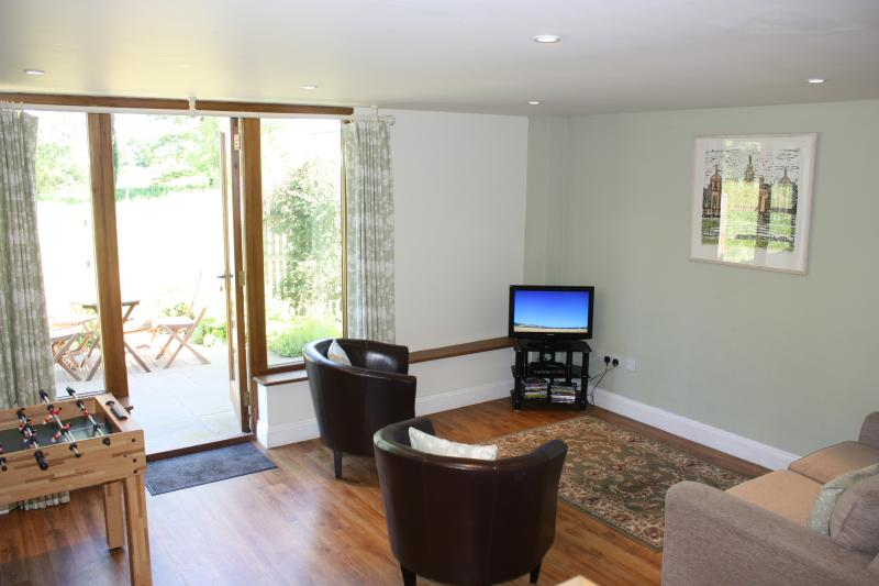 The family tv room leading to the breakfast terrace