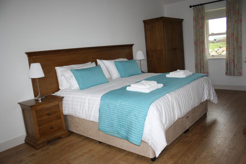Spacious bedroom with super king sized bed