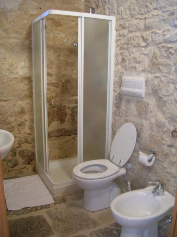 Stone bathroom with shower