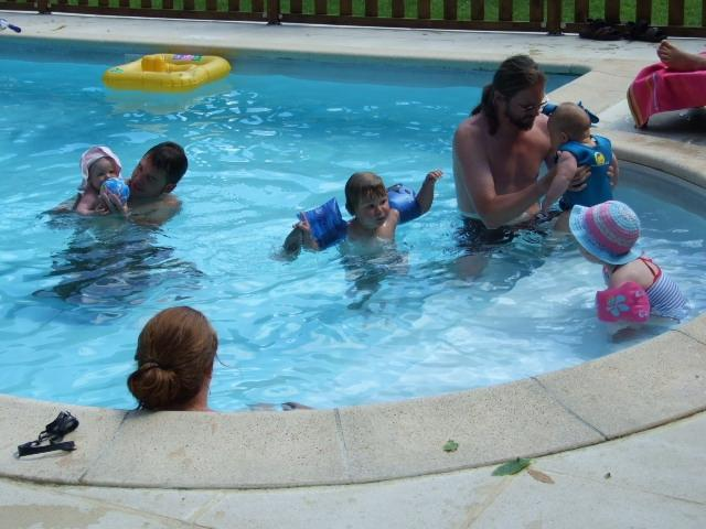 Water babes. The steps are a safe place for little ones to try out the water