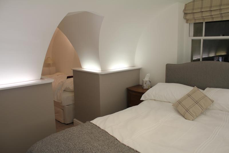 Double bedroom with 2 singles in adjoining room