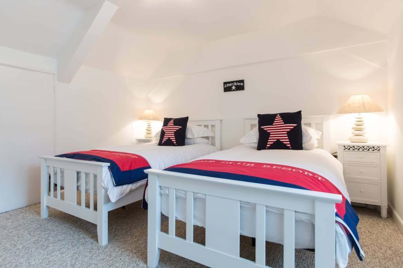 Second bedroom has twin beds