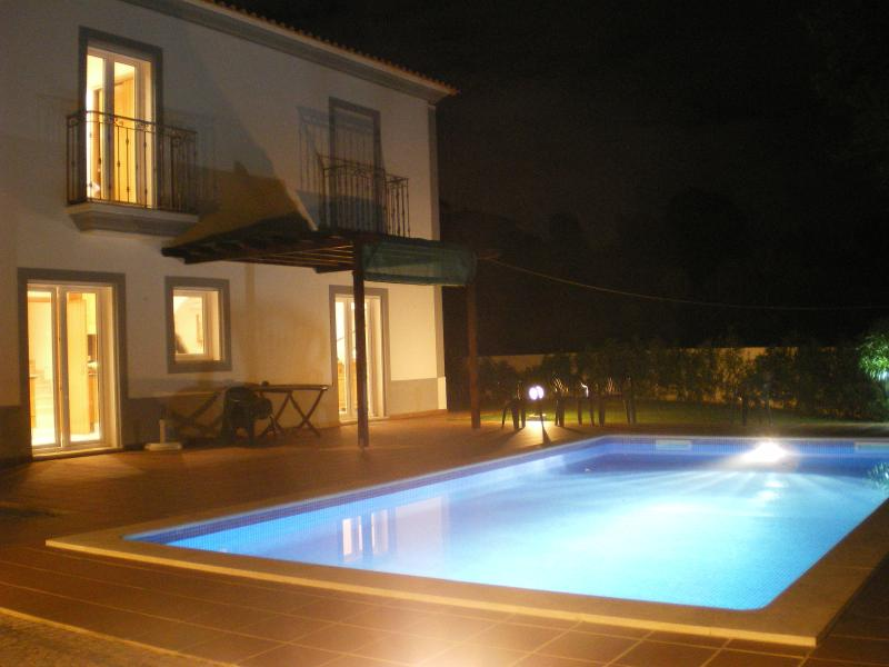 The Villa and pool at night