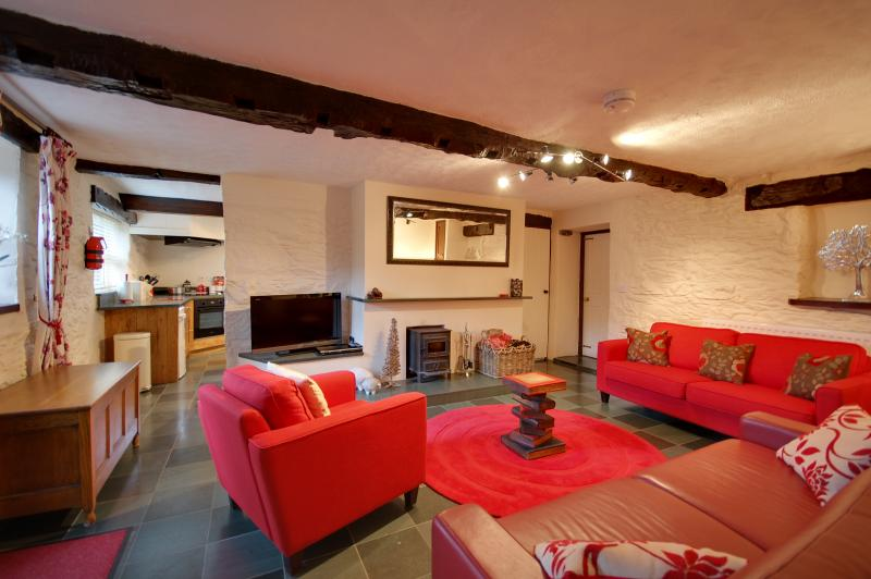 Spacious lounge in Byre with slate flooring, log stove and exposed beams