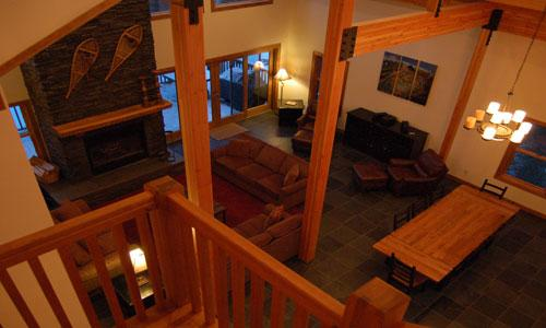 FIR TREE LODGE : Enjoy the open space of the great room and warm yourself by either the indoor or outdoor wood burning fireplace...or both...!