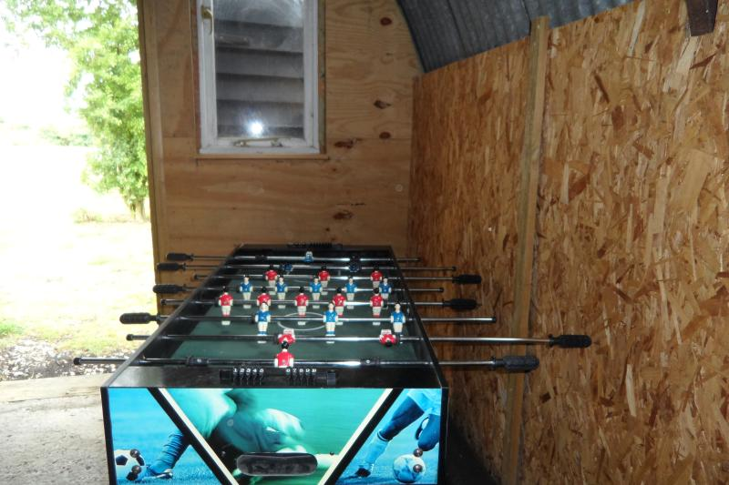Table top football in Nissan Hut