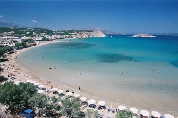 The beautyful beach in Almyrida with golden sand and crystal clear waters