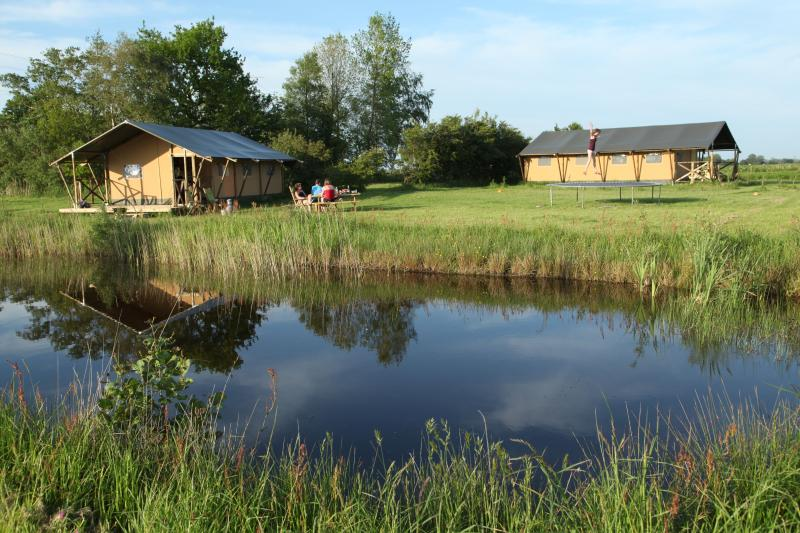 Our safari tents are situated between green pastures and waterways