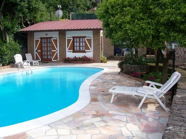 The Cottage is just in front of the pool and overlooking the lake