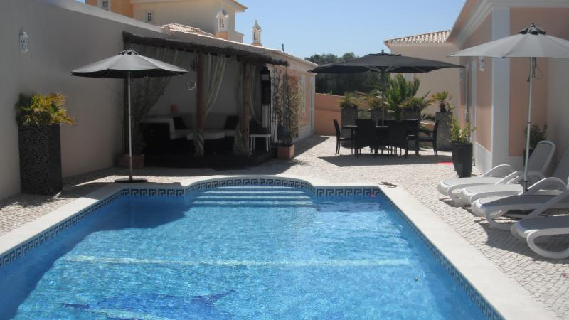 Heated pool with all day sun. Gazebo and umbrellas offering poolside shade
