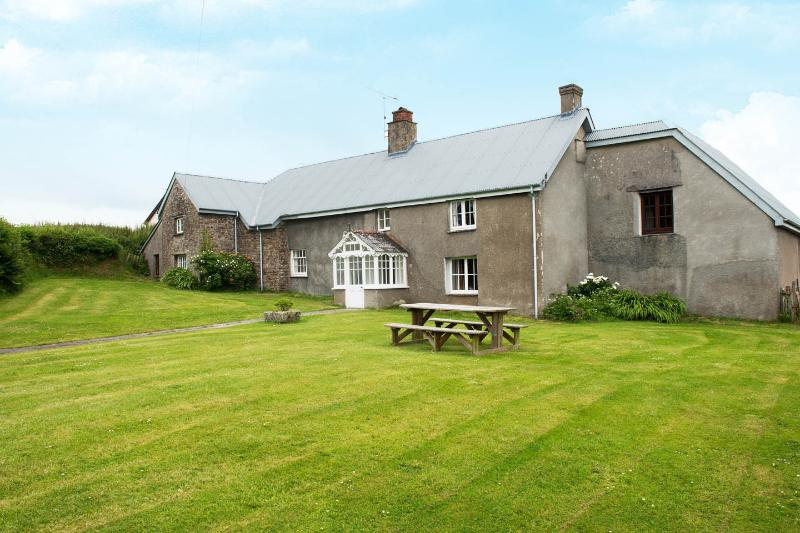 Well Farmhouse with large front lawn
