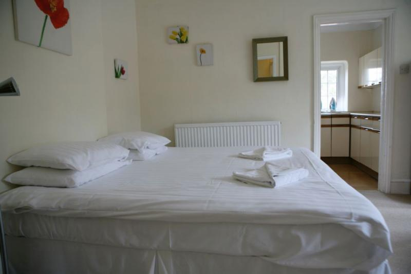 Downstairs bedroom, private entrance and en-suite shower room. Can be double or twin