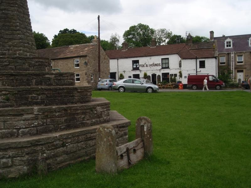Village Green Stocks and Pub -The Fox and Hounds -500 yards
