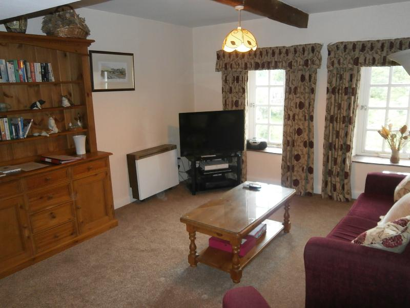 Lounge with 40ins television and new carpet June 2014. View downstream to Wensleydale