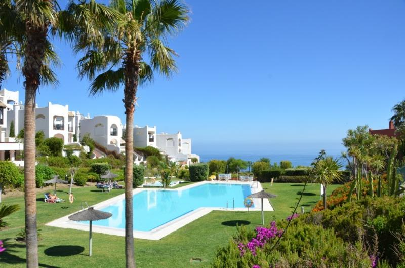 Community Pool with babypool surrounded by a wonderful mediterranean garden. With sunbeds & para