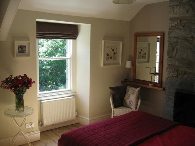 Bedroom with view of distant hills
