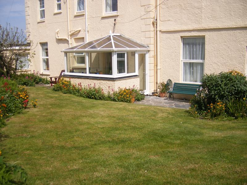 'Delfi' - sunny side apartment with conservatory; patio; private lawned garden and car parking space