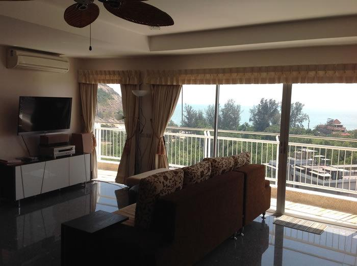 Living room with large couch, tv/home theater,  air conditioning. Mountain & beach views.