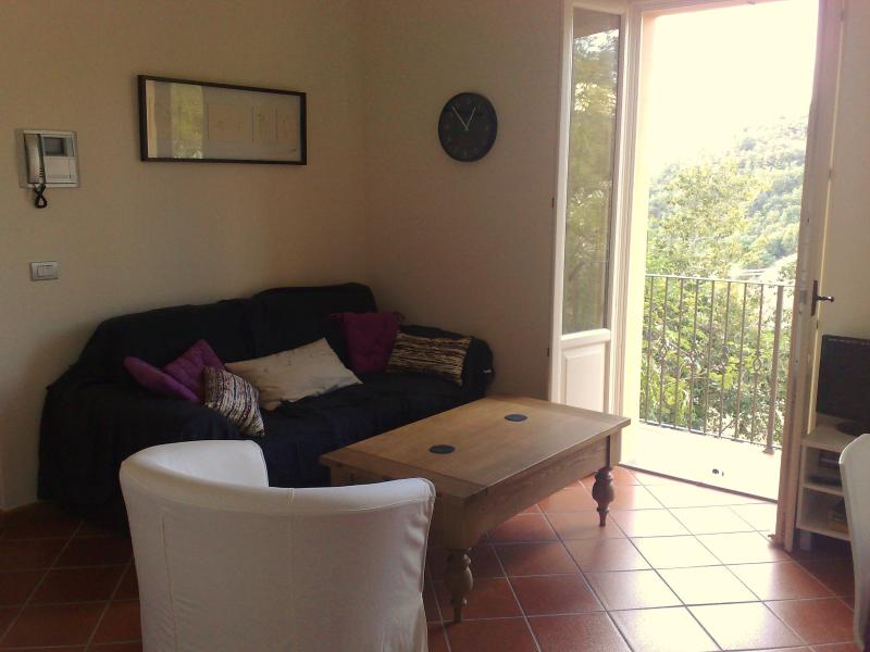 Lounge with French doors out to private garden, balcony and beautiful views