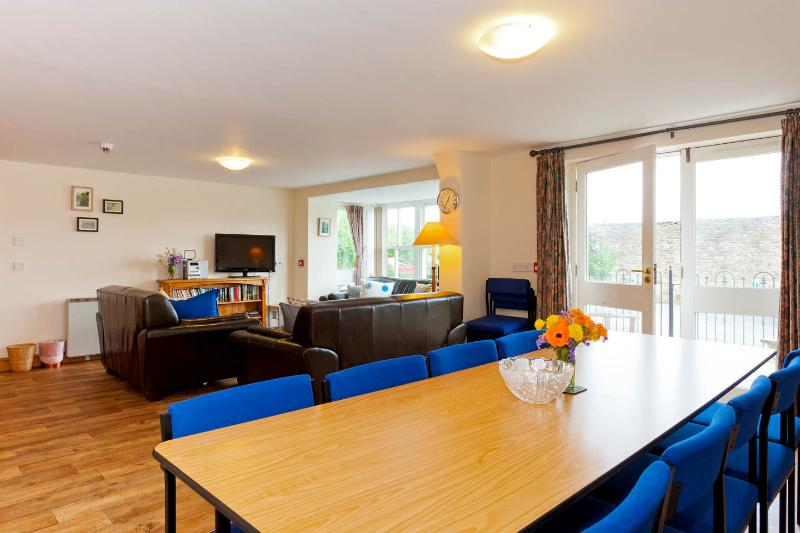 Large lounge and dining area in Howgills Guest House apartment in Sedbergh