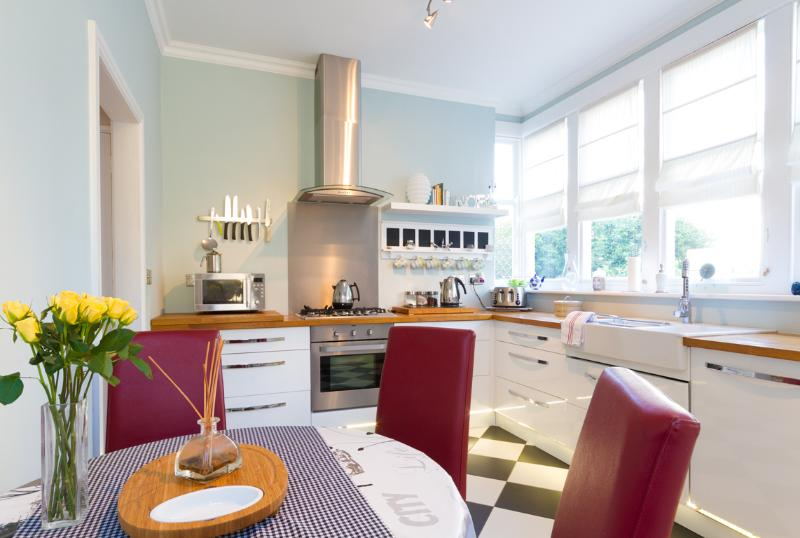 Delightful kitchen with solid wood worktops and relaxed seating