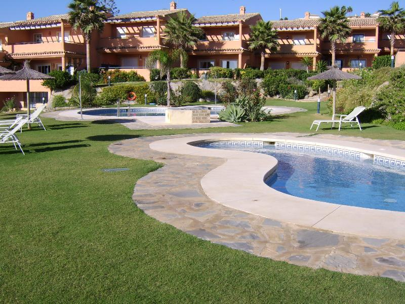 Bermuda Beach Estepona Landscaped gardens with pool and kiddies paddle pool