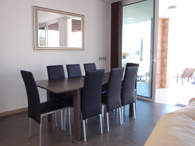 Dining room area leading to terrace and swimming pool.