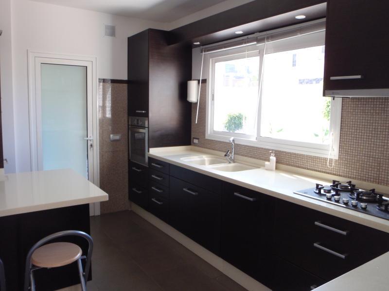 Spacious modern separate kitchen.