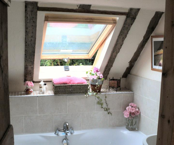A luxury bathroom with spa bath, lots of bubbles and candles to relax you after a long day.