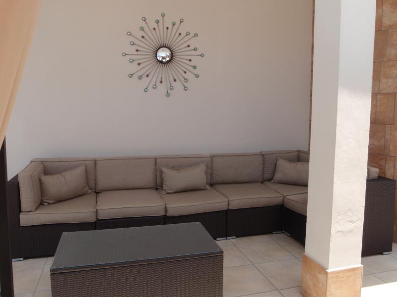 Relaxing large rattan sofa.