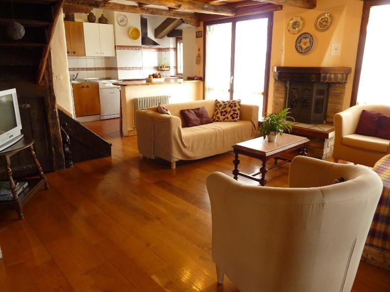 Integrado na sala com lareira sala de estar virada a sul com vistas espectaculares.