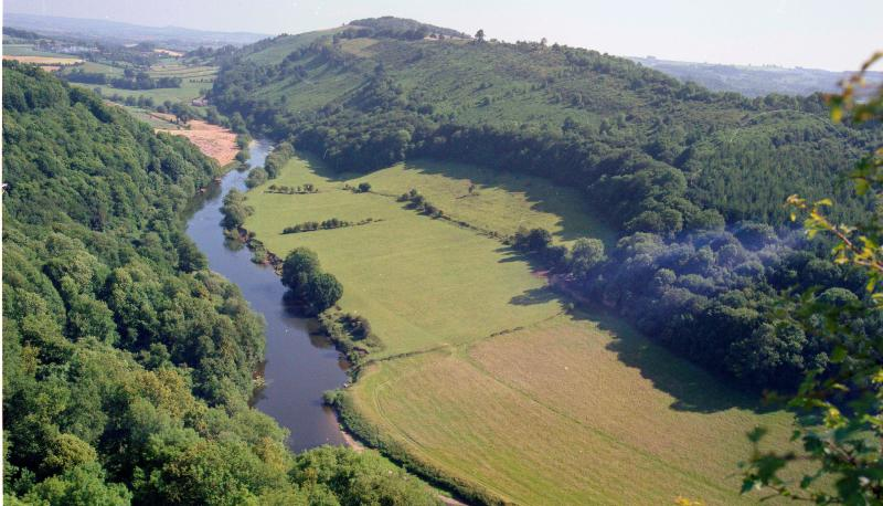 Summer at Symonds Yat rock. Peregrine Falcons can be seen nesting. Pubs, river cruise and canoeing.