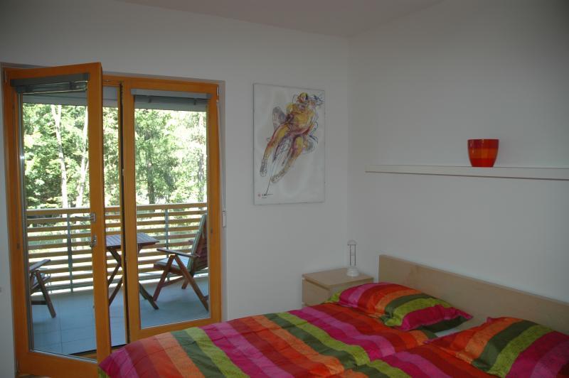 Master bedroom with opened balcony door