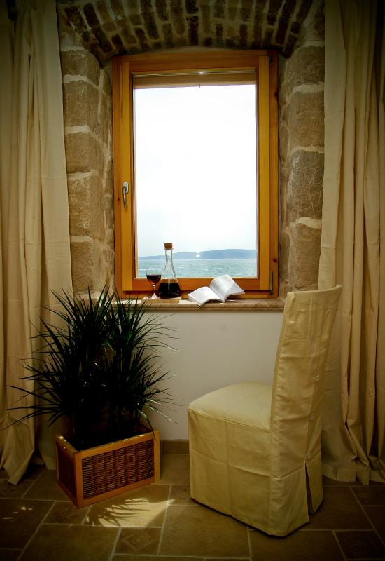 You apartment windows look out onto a 16th Century Sea Fort (Kastel Stafilic) and the Sea