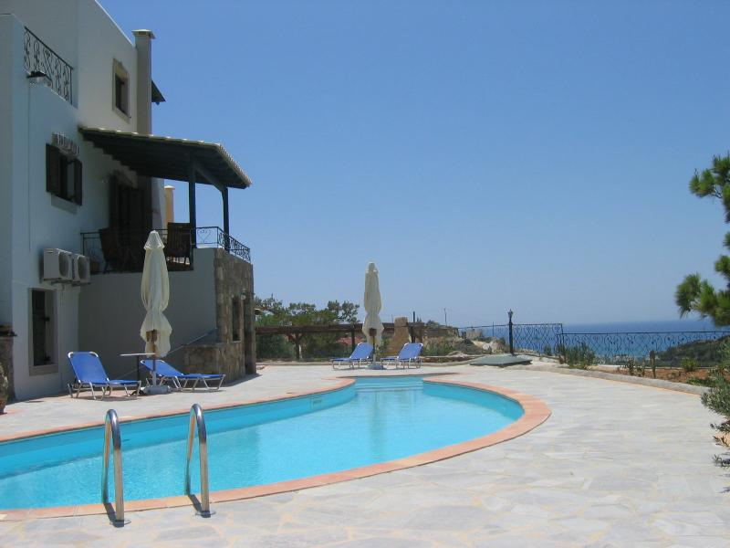 A stunning view by the pool looking to the sea. A quiet,private and peaceful location.