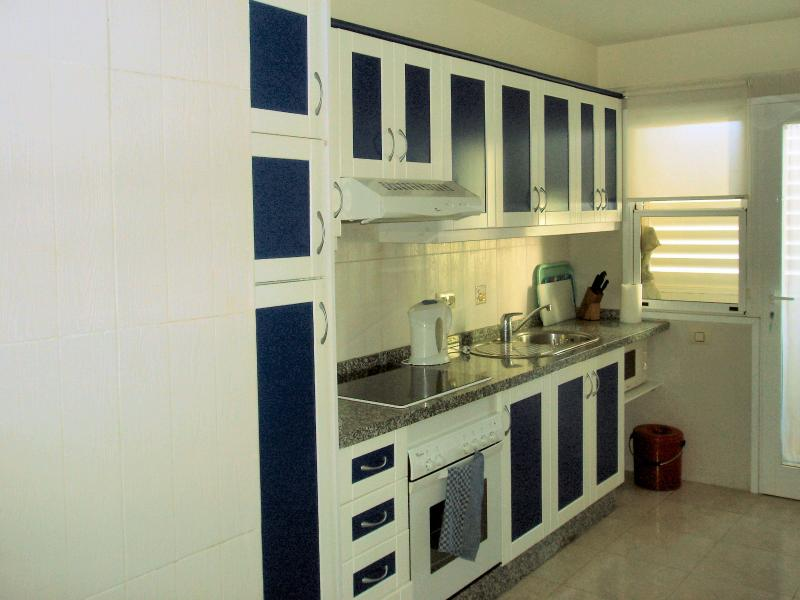 a fully equipped   separate kitchen