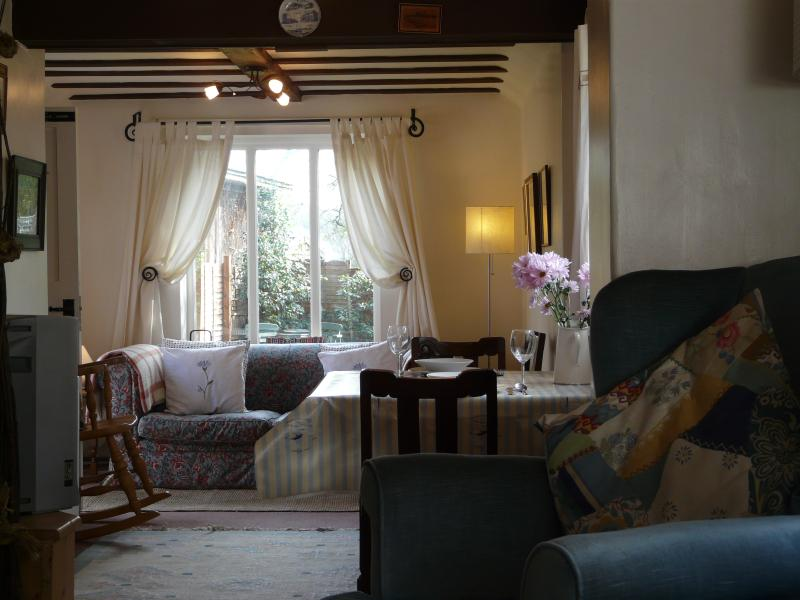 View of living area with large windows overlooking the garden for birdwatching.